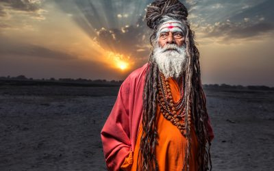 Sadhu standing with sunrise behind him