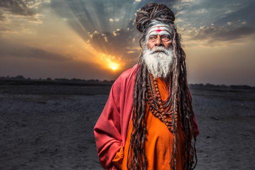 Sadhu standing with sunrise behind him