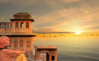 Man watching sunrise at ancient hindu temple