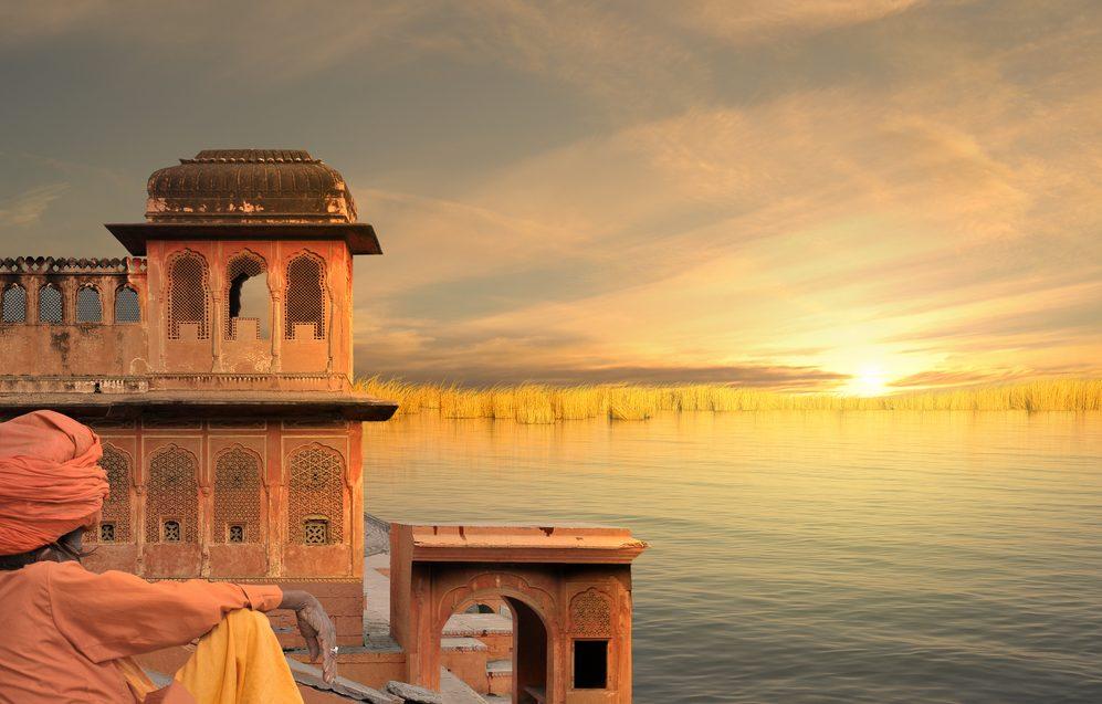Man watching sunrise at ancient hindu temple